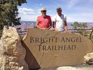 Bright Angel Trailhead sign with workers | Photo by Mike Buchheit