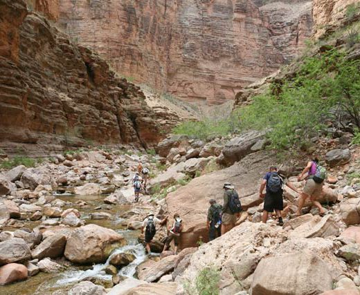 Hikers in Kanab Canyon | Photo by Mike Buchheit