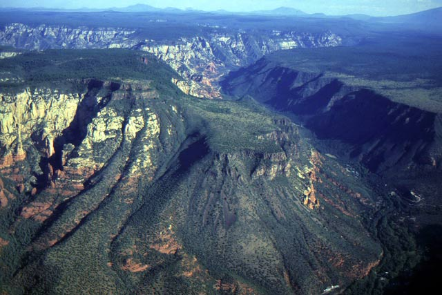 Aerial view of Oak Creek Canyon to the north. This view clearly shows how the capping lava flows on Wilson Mountain (left) are displaced along the Oak Creek Fault to form Wilson Bench (center). | Photo by Wayne Ranney