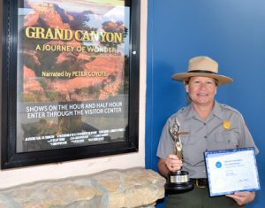 Grand Canyon Chief of Interpretation and Resource Education Judy Hellmich-Bryan holds park Aurora and NAI Awards. NPS Photo by Michael Quinn