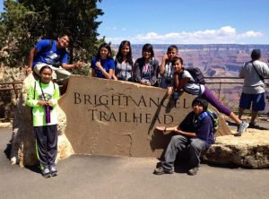 Young Hikers pose at new Bright Angel Trailhead sign | Photo by Mike Buchheit