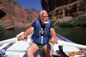 Martin Litton, pictured in 1991, rowing a dory on the Colorado River in Grand Canyon National Park, Arizona. He was active in protecting the environment in the days before his death.