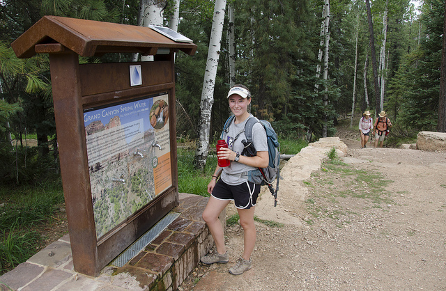 Hiker filling water bottle at North Rim Water Station | NPS photo by Mike Quinn
