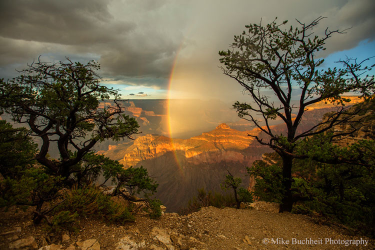 A rainbow descends into the canyon just beyond Yavapai Point during a monsoon sunset | Photo by Mike Buchheit