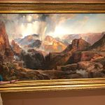 "Author Mike Buchheit stands in front of Thomas Moran's ""Chasm of the Colorado"""