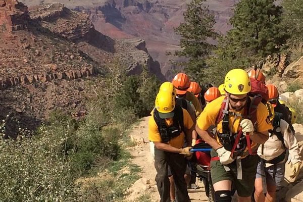 A search and rescue team assist in a litter carry up the Bright Angel Trail | NPS Photo by J. Baird